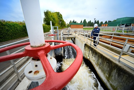 A Veolia employee samples wastewater discharge at the Gresham Wastewater Treatment Plant. Sampling helps ensure that water quality standards are met.