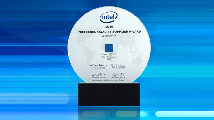 Intel's glass, circular award for Preferred Quality Supplier against blue background
