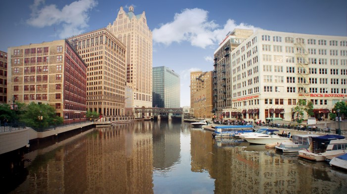 Milwaukee River surrounded by city buildings.